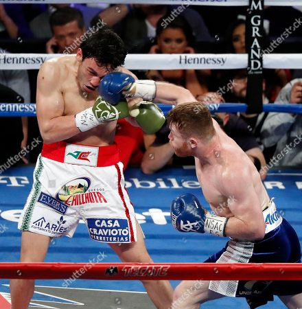 Stock Picture of Canelo Alvarez, of Mexico, right, punches Julio Cesar Chavez Jr., of Mexico, during their catch weight boxing match, in Las Vegas
