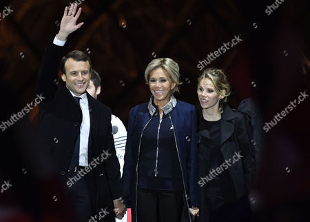 French president-elect Emmanuel Macron (L) and his wife Brigitte Trogneux (C) with her daughter Tiphaine Auziere (R) celebrate on stage after winning the second round of the French presidential elections at the Carrousel du Louvre in Paris, France, 07 May 2017. Emmanuel Macron defeated Marine Le Pen in the final round of France's presidential election, with exit polls indicating that Macron is leading with approximately 65.5 per cent of the vote.