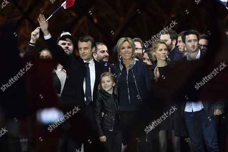 French president-elect Emmanuel Macron (L) and his wife Brigitte Trogneux (C) and her daughter Tiphaine Auziere (2-R) celebrate on stage after winning the second round of the French presidential elections at the Carrousel du Louvre in Paris, France, 07 May 2017. Emmanuel Macron defeated Marine Le Pen in the final round of France's presidential election, with exit polls indicating that Macron is leading with approximately 65.5 per cent of the vote.