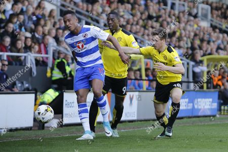 Reading midfielder Jordan Obita (11) and Burton Albion striker Marvin Sordell (9) ad Burton Albion midfielder Will Miller (18) during the EFL Sky Bet Championship match between Burton Albion and Reading at the Pirelli Stadium, Burton upon Trent
