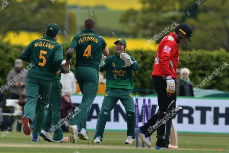 James Pattinson and Chris Read celebrate the wicket of Tom Wells during the Royal London 1 Day Cup match between Nottinghamshire County Cricket Club and Leicestershire County Cricket Club at Wellbeck Colliery Cricket Club, Nettleworth