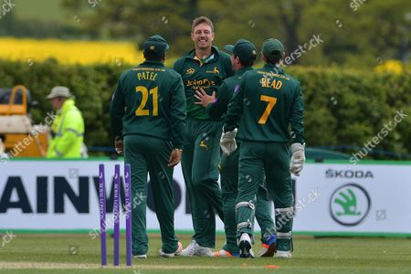 Stock Photo of James Pattinson and Chris Read celebrate the wicket of Tom Wells (not shown) during the Royal London 1 Day Cup match between Nottinghamshire County Cricket Club and Leicestershire County Cricket Club at Wellbeck Colliery Cricket Club, Nettleworth