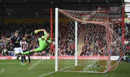 Stock Photo of Brentford goalkeeper David Bentley is beaten by the opening goal, a free kick taken by Charlie Mulgrew of Blackburn Rovers during the Sky Bet Championship match between Brentford and Blackburn Rovers played at Griffin Park, London on 7th May 2017