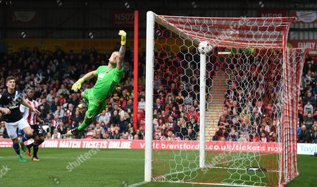 Stock Image of Brentford goalkeeper David Bentley is beaten by the opening goal scored by Charlie Mulgrew of Blackburn Rovers during the Sky Bet Championship match between Brentford and Blackburn Rovers played at Griffin Park, London on 7th May 2017