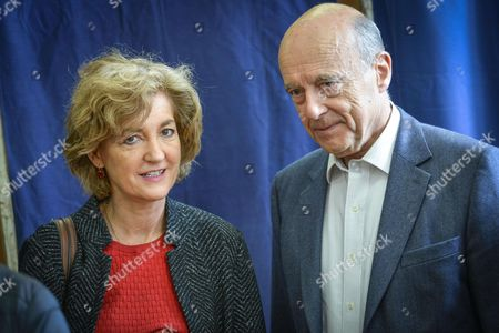 Alain Juppe and his wife Isabelle Juppe at polling station to vote for the second round of 2017 presidential elections in Bordeaux