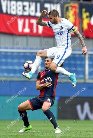 Inter's forward Mauro Icardi (top) and Genoa's defender Nicolas Burdisso vie for the ball  during the Italian Serie A soccer match between Genoa CFC and Inter Milan at Luigi Ferrari Stadium in Genoa, Italy, 07 May 2017.