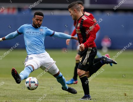 Greg Garza, Rodney Wallace Atlanta United defender Greg Garza, right, defends New York City FC forward Rodney Wallace during the first half of an MLS soccer game, in New York