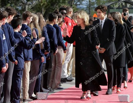 Caroline Kennedy Schlossberg, Jack Schlossberg Former U.S. Ambassador to Japan Caroline Kennedy Schlossberg, center, and her son Jack Schlossberg, center right, greet members of Massachusetts state service organizations as they arrive at the John F. Kennedy Presidential Library and Museum before the 2017 Profile in Courage award, in Boston. Former President Barack Obama is to be presented with the award during the ceremonies