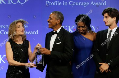 Caroline Kennedy, Barack Obama, Michelle Obama, Jack Schlossberg Former President Barack Obama, second from left, is presented with the 2017 Profile in Courage award by former U.S. Ambassador to Japan Caroline Kennedy, left, as former first lady Michelle Obama, second from right, and Kennedy's son Jack Schlossberg, right, look on during ceremonies at the John F. Kennedy Presidential Library and Museum, in Boston