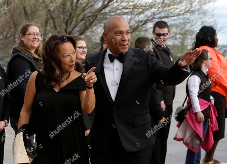 Former Massachusetts Governor Deval Patrick, right, arrives with his wife, Diane, at the John F. Kennedy Presidential Library and Museum before the 2017 Profile in Courage award, in Boston. Former President Barack Obama was presented with the award during the ceremonies