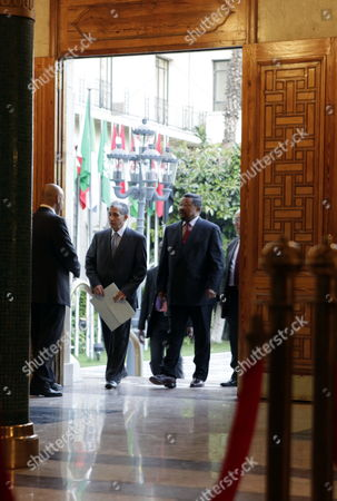 The Chairperson of the African Union Commission Jean Ping (3-l) Arrives For a Meeting with Arab League Secretary General Nabil Elaraby (not Pictured) at the Arab League Headquarters in Cairo Egypt 03 September 2011 According to Local Media Sources Secretary General of the Arab League Nabil Elaraby and Egypt's Foreign Minister Mohammed Kamel Amr Met on 03 September with African Union (au) Chaireperson Jean Ping and Organization of the Islamic Conference (oic) Representative to Discuss the Palestinian Project of Requesting the Recognition of a Palestinian State by the United Nations Later in September Egypt Cairo