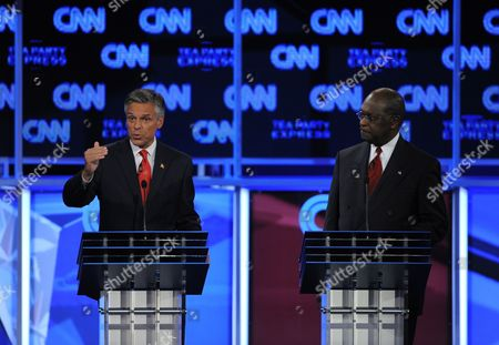 Republican Presidential Candidate Jon Huntsman Jr (l) Addresses the Moderator As Herman Cain (r) Looks on During the Cnn Tea Party Republican Debate in Tampa Florida Usa 12 September 2011 Eight Republican Presidential Candidates Participated in the Debate United States Tampa