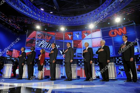 Republican Presidential Candidates (l-r) Jon Huntsman Jr Herman Cain Michele Bachmann Mitt Romney Rick Perry Ron Paul Newt Gingrich and Rick Santorum Stand For the National Anthem at the Start of the Cnn Tea Party Republican Debate in Tampa Florida Usa 12 September 2011 Eight Republican Presidential Candidates Participated in the Debate United States Tampa