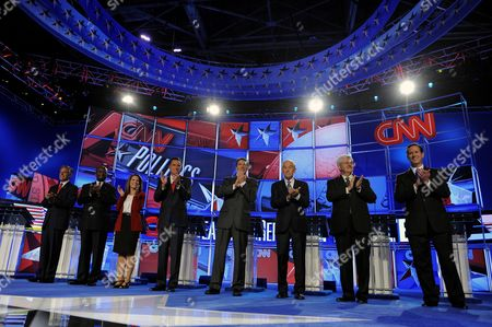 Republican Presidential Candidates (l-r) Jon Huntsman Jr Herman Cain Michele Bachmann Mitt Romney Rick Perry Ron Paul Newt Gingrich and Rick Santorum Stand For a Photo at the Start of the Cnn Tea Party Republican Debate in Tampa Florida Usa 12 September 2011 Eight Republican Presidential Candidates Participated in the Debate United States Tampa
