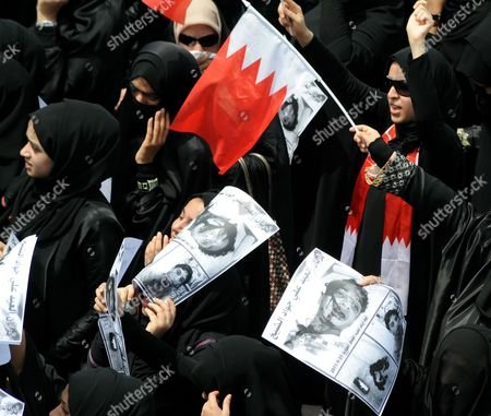 Bahraini Women Take Part in the Funeral Procession of Killed 14-year-old Bahraini Ali Jawad Al-sheikh During a Funeral Procession in Sitra Village South-west of the Bahraini Capital Manama on 01 September 2011 Attended by Thousands Al-sheikh Had Died a Day Earlier on 31 August 2011 the First Day of Marking Eid El-fitr For Many Shiites in Bahrain by Anti-riot Police As They Chased Him Down According to Family and Fellow Protesters Bahraini Police Denied Being Involved in the Incident Sighting That No Clashes Were Taking Place in the Area at the Time the Police Also Said That They Were Investigating the Incident Bahrain Sitra
