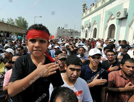 A Young Boy Beats His Chest During the Funeral Procession of Killed 14-year-old Bahraini Ali Jawad Al-sheikh During a Funeral Procession in Sitra Village South-west of the Bahraini Capital Manama on 01 September 2011 Attended by Thousands Al-sheikh Had Died a Day Earlier on 31 August 2011 the First Day of Marking Eid El-fitr For Many Shiites in Bahrain by Anti-riot Police As They Chased Him Down According to Family and Fellow Protesters Bahraini Police Denied Being Involved in the Incident Sighting That No Clashes Were Taking Place in the Area at the Time the Police Also Said That They Were Investigating the Incident Bahrain Sitra