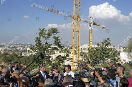 Israel's Deputy Foreign Minister Danny Ayalon (c-l) in Front of Working Cranes in the Jerusalem 'Neighborhood' of Gilo During a Press Conference on 02 October 2011 Both Ayalon and Naomi Tzur (c-r) the Deputy Mayor of Jerusalem who Accompanied Ayalon Stressed That Gilo where Israel Has Just Approved the Construction of Some 1 100 Additional Housing Units Should not Be Considered a 'Settlement ' But the Press Should Refer to It As a 'Neighborhood' of Jerusalem Gilo is Home to Over 40 000 Israelis and was Established in 1973 It is Built Over the 'Green Line' of 1967 and Its Land was was Annexed by Israel Following the 1967 Six Days War Israel Jerusalem