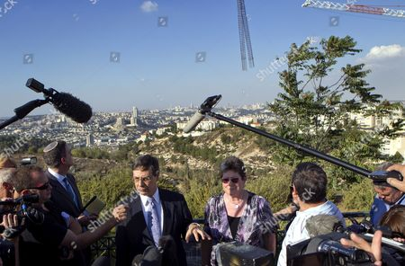 Israel's Deputy Foreign Minister Danny Ayalon (c-l) in Front of a Working Crane Hoisting a Tube of Steel Bars As He and Naomi Tzur the Deputy Mayor of Jerusalem (c-r) Give a Press Conference in the Gilo 'Neighborhood' of Jerusalem on 02 October 2011 in the Background is the Main Area of Jerusalem Looking North and West From Gilo Israel Has Just Approved the Construction of Some 1 100 Additional Housing Units Here Which Has Caused a Row Especially with the United States and Germany and Both Stressed in the Press Tour That Gilo Should not Be Considered a 'Settlement ' But It Should Be Referred to As a 'Neighborhood' of Jerusalem Gilo is Home to Over 40 000 Israelis and was Established in 1973 It is Built Over the 'Green Line' of 1967 and Its Land was was Annexed by Israel Following the 1967 Six Days War Israel Jerusalem