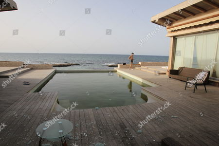 A View of the Swimming Pool of the Ransacked Summer House of Hannibal Gaddafi Son of Muammar Gaddafi at the Select Regata Beach Resort in Tripoli on 01 September 2011 Algeria's Foreign Ministry Had Confirmed on 30 August 2011 That Gaddafi's Wife Safia and Three of His Eight Children the Daughter and Two Sons Hannibal and Mohamed Had Crossed the Libyan-algerian Border Meanwhile the Fugitive Libyan Leader Muammar Gaddafi is 'Hiding' in a Desert Town Outside Tripoli Planning a Fightback a Senior Rebel Commander Said 01 September the Exact Whereabouts of Gaddafi Remained Unknown on 01 September Marking the 42nd Anniversary of His Seizing Power in the Northern African Country in a Military Coup Libyan Arab Jamahiriya Tripoli