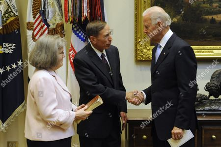 Us Vice President Joe Biden (r) Shakes Hands with General David Petraeus (c) After Swearing Him in As Director of the Central Intelligence Agency (cia) As Holly Petraeus (l) Looks on in the Roosevelt Room of the White House in Washington Dc Usa 06 September 2011 United States Washington