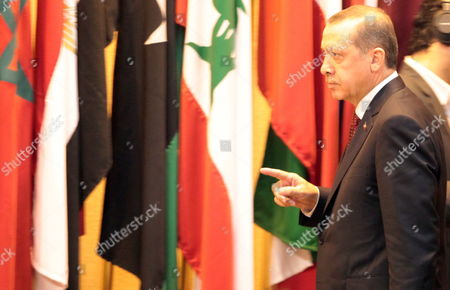Turkish Prime Minister Recep Tayyip Erdogan Arrives For the Opening Session of Arab Foreign Ministers Meeting in Cairo Egypt 13 September 2011 Turkish Prime Minister Recep Tayyip Erdogan Arrived in Egypt Late 12 September on an Official Visit He Held a Series of Meetings in Cairo on 13 September Which Were Due to Focus on Military and Diplomatic Ties Between the Two Countries He Met with the Head of the Ruling Military Council Field Marshal Mohamed Hussein Tantawi and His Egyptian Counterpart Essam Sharaf and Gave a Speech to the Arab League Foreign Ministers Meeting He Will Also Give Another Speech Later the Same Day to a Group of Different Egyptian Political Figures at the Cairo Opera House Erdogan is Currently Seen As a Hero by Many Egyptians After Cutting All Diplomatic Relations and Freezing Military and Trade Ties with Israel the Previous Week Over Last Year's Killing of Nine Turkish Activists Aboard a Gaza-bound Ship Meant to Deliver Humanitarian to the Palestinian Population Egypt Cairo