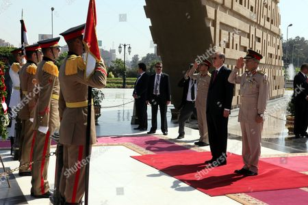 Turkish Prime Minister Recep Tayyip Erdogan (2-r) Reviews Honour Guards During His Visit to the Tomb of the Unknown Soldier in Cairo Egypt 13 September 2011 Erdogan Arrived in Egypt on 12 September to Hold a Series of Meetings That Will Chiefly Focus on Military and Diplomatic Ties Between the Two Countries He is Scheduled to Meet with the Head of the Ruling Military Council Field Marshal Mohamed Hussein Tantawi and His Egyptian Counterpart Essam Sharaf He Will Also Give Two Speeches the First to the Arab League Foreign Ministers Meeting and Another to a Group of Different Egyptian Political Figures Egypt Cairo