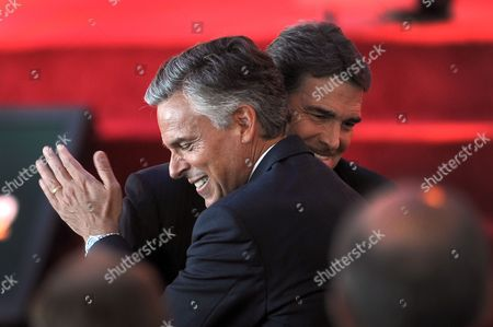 'Grand Old Party' (gop) Presidential Candidates Jon Huntsman Jr (l) and Rick Perry (r) Hug at the Reagan Centennial Gop Presidential Candidates Debate at the Reagan Library's Air Force One Pavilion in Simi Valley California Usa 07 September 2011 the Eight Republican Presidential Candidates Participated in the Debate United States Simi Valley