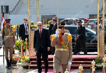 Turkish Prime Minister Recep Tayyip Erdogan (c) Arrives to Visit the Tomb of the Unknown Soldier in Cairo Egypt 13 September 2011 Erdogan Arrived in Egypt on 12 September to Hold a Series of Meetings That Will Chiefly Focus on Military and Diplomatic Ties Between the Two Countries He is Scheduled to Meet with the Head of the Ruling Military Council Field Marshal Mohamed Hussein Tantawi and His Egyptian Counterpart Essam Sharaf He Will Also Give Two Speeches the First to the Arab League Foreign Ministers Meeting and Another to a Group of Different Egyptian Political Figures Egypt Cairo