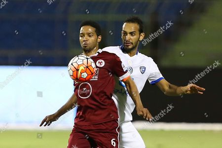 Al-faisaly Player Omr Abdulaziz (l) in Action For the Ball Witháal-hilaláplayer Abdullah Atif (r) During Theásaudi Professional League Soccer Match Betweenáal-hilal and Al-faisaly at Prince Faisal Bin Fahad Stadium in Riyadh Saudi Arabia 12 May 2016 Saudi Arabia Riyadh