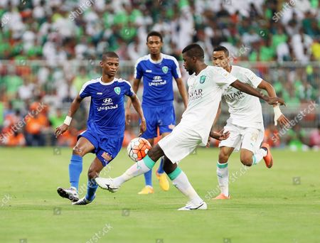 Stock Image of Al-fateh Player Majed Hazazi (l) in Action For the Ball with Al-ahli Player Mansoor Al-harbi (r) During the Saudi Professional League Soccer Match Between Al-ahli and Al-fateh at King Abdullah Al Jawhara International Stadium in Jeddah Saudi Arabia 13 May 2016 Saudi Arabia Jeddah