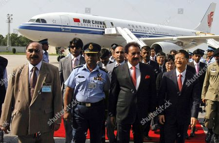 China's Public Security Minister Meng Jianzhu (2-r) Walks with Rehman Malik Pakistan's Interior Minister Upon Meng's Arrival at Chaklala Airbase in Rawalpindi Pakistan 26 September 2011 Meng Jianzhu Arrived in Islamabad on 26 September to Discuss Issues of Mutual Interest and Regional Security with the Pakistani Leadership Pakistan Rawalpindi