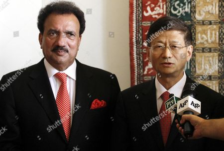 China's Public Security Minister Meng Jianzhu (r) and Rehman Malik Pakistan's Interior Minister Speak to Journalists Upon Meng's Arrival at Chaklala Airbase in Rawalpindi Pakistan 26 September 2011 Meng Jianzhu Arrived in Islamabad on 26 September to Discuss Issues of Mutual Interest and Regional Security with the Pakistani Leadership Pakistan Rawalpindi