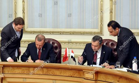 Turkish Prime Minister Recep Tayyip Erdogan (2-l) Signs Bilateral Agreements with His Egyptian Counterpart Essam Sharaf(2-r) Following Their Meeting in Cairo Egypt 13 September 2011 Erdogan Arrived in Egypt Late 12 September on an Official Visit He Held a Series of Meetings in Cairo on 13 September Which Were Due to Focus on Military and Diplomatic Ties Between the Two Countries He Met with the Head of the Ruling Military Council Field Marshal Mohamed Hussein Tantawi and His Egyptian Counterpart Essam Sharaf and Gave a Speeche to the Arab League Foreign Ministers Meeting He Will Also Give Another Speech Later the Same Day to a Group of Different Egyptian Political Figures at the Cairo Opera House Erdogan is Currently Seen As a Hero by Many Egyptians After Cutting All Diplomatic Relations and Freezing Military and Trade Ties with Israel the Previous Week Over Last Year's Killing of Nine Turkish Activists Aboard a Gaza-bound Ship Meant to Deliver Humanitarian to the Palestinian Population Egypt Cairo
