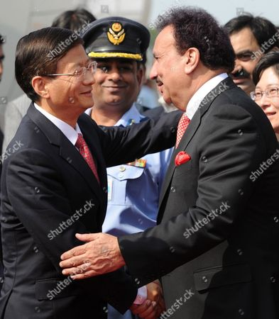 China's Public Security Minister Meng Jianzhu (l) Shakes Hands with Rehman Malik Pakistan's Interior Minister Upon Meng's Arrival at Chaklala Airbase in Rawalpindi Pakistan 26 September 2011 Meng Jianzhu Arrived in Islamabad on 26 September to Discuss Issues of Mutual Interest and Regional Security with the Pakistani Leadership Pakistan Rawalpindi