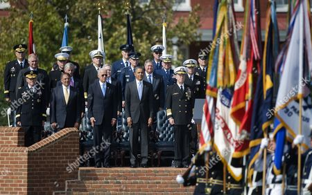 Us President Barack Obama (4-l) Vice President Joseph Biden (3-l) Secretary of Defense Leon Panetta (2-l) the 18th Chairman of the Joint Chiefs of Staff Army General Martin Dempsey (l) and 17th Chairman of the Joint Chiefs of Staff Admiral Mike Mullen Watch As the Colors Are Retired During an Armed Forces Farewell Tribute and Swearing-in Ceremony in Honor of the 17th and 18th Chairman of the Joint Chiefs of Staff at Summerall Field Joint Base Myer-henderson Hall Virginia Usa 30 September 2011 Admiral Mullin is Being Succeded by Army General Martin Dempsey United States Washington