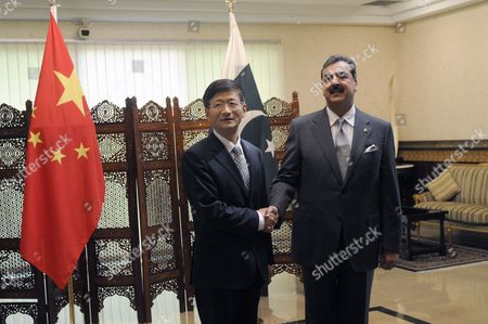 China's Vice Premier who is Also Public Security Minister Meng Jianzhu (l) Shakes Hands with Pakistan's Prime Minister Yusuf Raza Gilani (r) During Their Meeting in Islamabad Pakistan 27 September 2011 Meng Jianzhu Arrived in Islamabad on 26 September to Discuss Issues of Mutual Interest and Regional Security with Pakistani Leadership Pakistan Islamabad