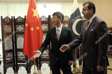 China's Vice Premier who is Also Public Security Minister Meng Jianzhu (l) Walks with Pakistan's Prime Minister Yusuf Raza Gilani During Their Meeting in Islamabad Pakistan 27 September 2011 Meng Jianzhu Arrived in Islamabad on 26 September to Discuss Issues of Mutual Interest and Regional Security with Pakistani Leadership Pakistan Islamabad