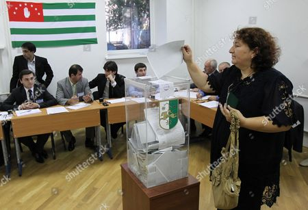 A Voter Casts Her Ballot at Polling Station Number 4 in Donskaya Street in Moscow Russia 26 August 2011 During Abkhazia's Presidential Elections the Breakaway Georgian Region of Abkhazia Holds Its Fifth Presidential Election Since the Post of Abkhazia's President was Created in 1994 and the Second Election Since Russia Recognized the Separatist Republics of Abkhazia and South Ossetia As Independent States Following a Short Five Day War Between Georgia and Russia in August 2008 Three Candidates ? Prime Minister Sergei Shamba Vice President Alexander Ankvab and Former Vice President and Opposition Leader Raul Khadzhimba - Are Running For the Presidency to Succeed Late President Sergei Bagapsh who Unexpectedly Died 29 May 2011 Russian Federation Moscow