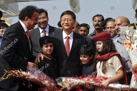 China's Public Security Minister Meng Jianzhu (c) and Rehman Malik (l) Pakistan's Interior Minister Pose For a Photograph with Pakistani Children Upon Meng's Arrival at Chaklala Airbase in Rawalpindi Pakistan 26 September 2011 Meng Jianzhu Arrived in Islamabad on 26 September to Discuss Issues of Mutual Interest and Regional Security with the Pakistani Leadership Pakistan Rawalpindi