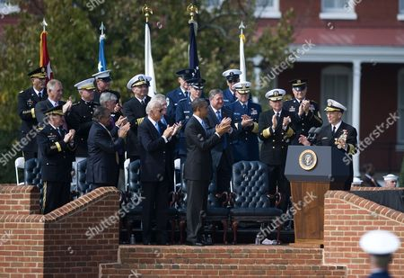 Us President Barack Obama (4-l) Vice President Joseph Biden (3-l) Secretary of Defense Leon Panetta (2-l) and the 18th Chairman of the Joint Chiefs of Staff Army General Martin Dempsey (l) Listen to the 17th Chairman of the Joint Chiefs of Staff Admiral Mike Mullen (r) During an Armed Forces Farewell Tribute and Swearing-in Ceremony in Honor of the 17th and 18th Chairman of the Joint Chiefs of Staff at Summerall Field Joint Base Myer-henderson Hall Virginia Usa 30 September 2011 Admiral Mullen is Being Succeded by Army General Martin Dempsey United States Washington