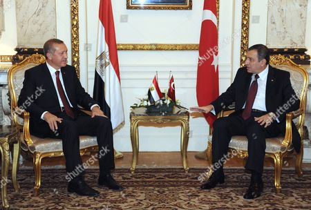 Turkish Prime Minister Recep Tayyip Erdogan (l) Meets Withhis Egyptian Counterpart Essam Sharaf in Cairo Egypt 13 September 2011 Erdogan Arrived in Egypt Late 12 September on an Official Visit He Held a Series of Meetings in Cairo on 13 September Which Were Due to Focus on Military and Diplomatic Ties Between the Two Countries He Met with the Head of the Ruling Military Council Field Marshal Mohamed Hussein Tantawi and His Egyptian Counterpart Essam Sharaf and Gave a Speeche to the Arab League Foreign Ministers Meeting He Will Also Give Another Speech Later the Same Day to a Group of Different Egyptian Political Figures at the Cairo Opera House Erdogan is Currently Seen As a Hero by Many Egyptians After Cutting All Diplomatic Relations and Freezing Military and Trade Ties with Israel the Previous Week Over Last Year's Killing of Nine Turkish Activists Aboard a Gaza-bound Ship Meant to Deliver Humanitarian to the Palestinian Population Egypt Cairo