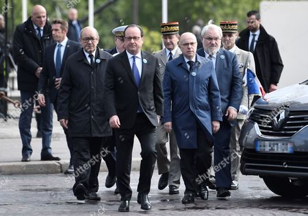 Outgoing French president Francois Hollande (C-L), flanked by Chief of the Defence Staff French army General Pierre de Villiers (C), French Defence Minister Jean-Yves Le Drian (L), French Prime Minister Bernard Cazeneuve (C-R) and French Junior Minister for Veterans Jean-Marc Todeschini (R) arrive to attend the ceremony marking the 72nd anniversary of the victory over Nazi Germany during WWII, under the Arc de Triomphe monument in Paris, France, 08 May 2017. Victory Day marks the day of the formal German defeat in World War II.