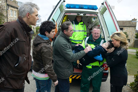 'Emmerdale'  TV - 2008 -   Terry Woods (Billy Hartman) is left anxious when he returns home to find TJ (Connor Lee) being rushed in to an ambulance. Louise Appleton (Emily Symons),  Jamie Hope (Alex Carter) and Jonny Foster (Richard Grieve) try to offer him support.