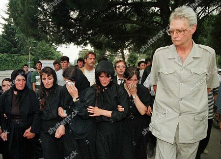Albaniam Would-be King Leka i (r) Stands Next to Mourning Women During the Funeral Ceremony For Agim Gjonpali in Tirana 5 July Gjonpali was Shot in Violent Clashes Between Albanian Monarchy Supporters with Police During a Rally in Tirana on Thursday 03 July Some 300 Relatives and Monarchy Supporters Attended the Funeral Ceremony This Saturday Afternoon Albania Tirana