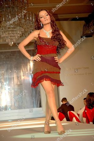 Bollywood Actress Celina Jaitley Takes to the Catwalk with a Diamond Necklace During a Fashion Show Organized by Diamond Trading Company in Bombay India Late Friday 04 March 2005