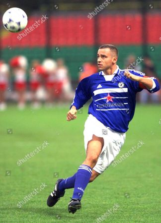 Warsaw Poland: Italian Musician Eros Ramazotti Shows His Skills As a Soccer Player During a Charity Match Between Italian and Polish Artists Saturday 25 September 1999 in Warsaw All Money Raised During the Match is For the Benefit of the Planned Project Tolerance School a School and Meeting Point For Children From All Ethnic Groups in the Kosovo Province