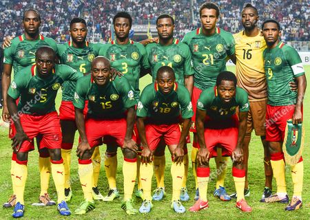 Fifa World Cup 2014 Teams Picture Taken on 13 October 2013 Shows Cameroonian National Soccer Team Players (front Row L-r) Dany Nounkeu Pierre Webo Eyong Enoh and Jean Makoun; (back Row L-r) Allan Nyom Alex Song Nicolas N'koulou Aurelien Chedjou Joel Matip Goalkeeper Charles Itandje and Captain Samuel Eto'o Posing For Photographers Before the Fifa World Cup 2014 Qualifying Soccer Match Between Tunisia and Cameroon in Rades Tunisia Team Cameroon is Among the 32 Squads That Qualified For the Fifa World Cup 2014 in Brazil Tunisia Rades