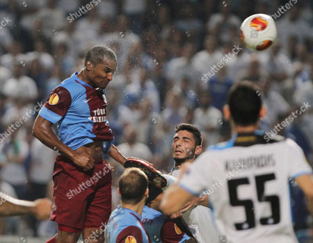 Florent Malouda of Trabzonspor Heads the Ball During the Uefa Europa League Group J Match Between Apollon Limassol and Trabzonspor at the Gsp Stadium in Nicosia Cyprus 19 September 2013 Cyprus Nicosia