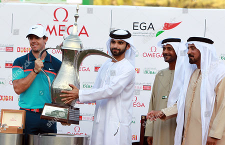 Rory Mcilroy of Northern Ireland is Presented with the Trophy by His Highness Sheikh Mansour Bin Mohammed Bin Rashid Al Maktoum As His Excellency Mubarak Sheikh Fahim Bin Sultan Al Qasimi Chairman of the Emirates Golf Federation and Mohammed Juma Buamaim the Vice-chairman and Ceo of Golf During the Omega Dubai Desert Classic 2015 Golf Tournament at Emirates Golf Club in Dubai United Arab Emirates 01 February 2015 United Arab Emirates Dubai