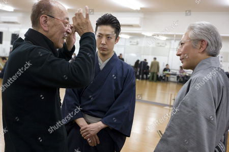 Actor Onoe Kikunosuke V (centre in blue) gets direction from theatre director Yukio Ninagawa (on left, in black), during rehearsals for theatre director Yukio Ninagawa's adaptation of 'Twelfth Night'